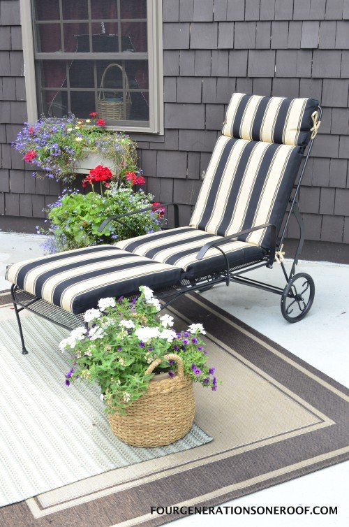 Lounge chair with black striped cushion + RESTORE concrete rolled over old cement