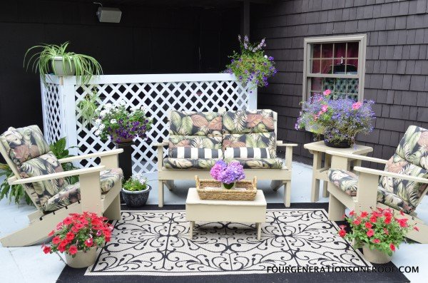 old cement patio fixed with RESTORE concrete + patio furniture