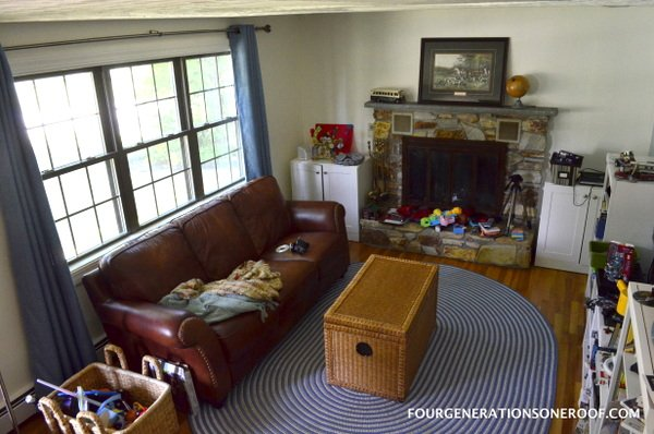 playroom with outdated fireplace