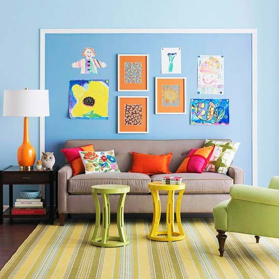 avoid winter blues in a kids playroom by adding bold colored paint to a wall