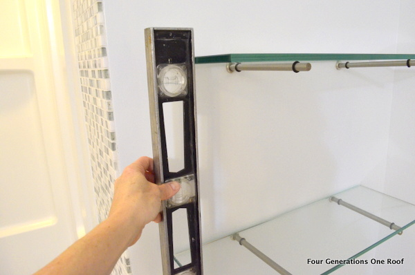 Glass shelves and metal bingo bracket