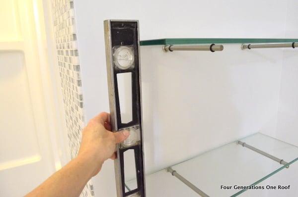 Glass shelves and metal bingo bracket