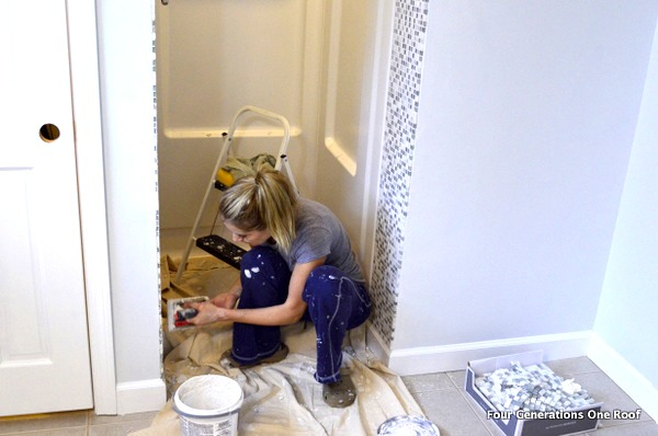 applying grout to the shower area