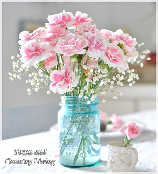 blue mason jar with pink flowers