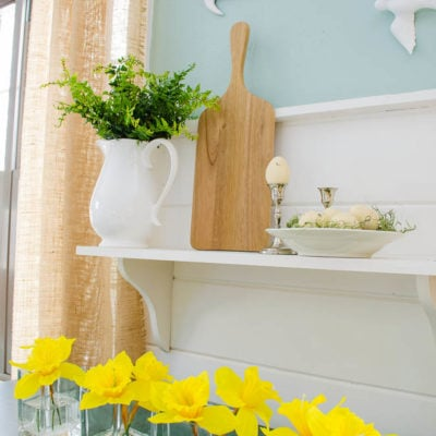 Boxwood and Forsythia spring mantel {mantle}