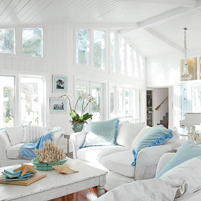 White Coastal Living Room With White Slipcover Sofas