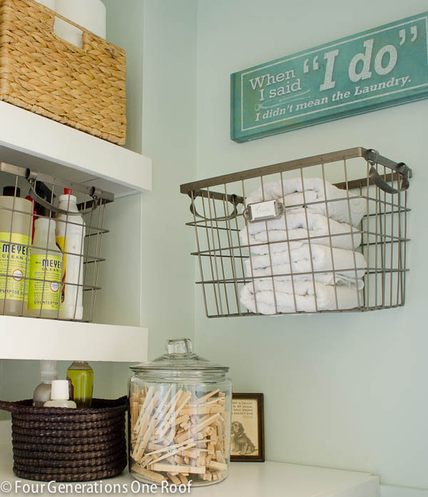laundry closet, side by side washer dryer, diy shelves, storage baskets, lazy susan, wire hanging basket, laundry sign, paper towels, folding table, green paint