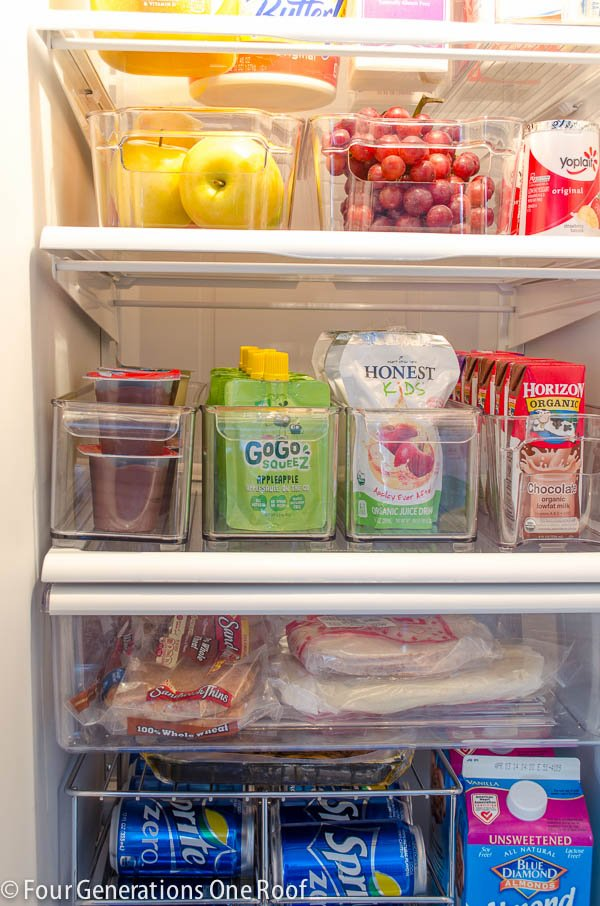 Clean refrigerator with plastic pull out bins for snacks, drinks and fruit