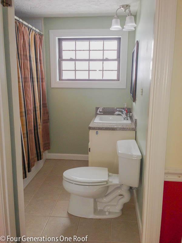 khaki green bathroom, brown striped shower curtain