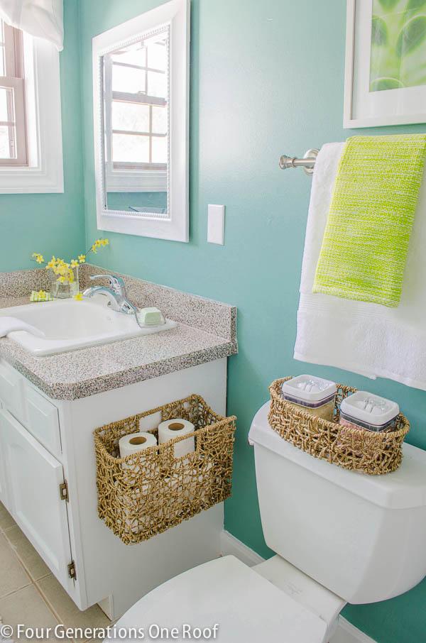 DIY hanging toilet paper storage basket on side of bathroom vanity