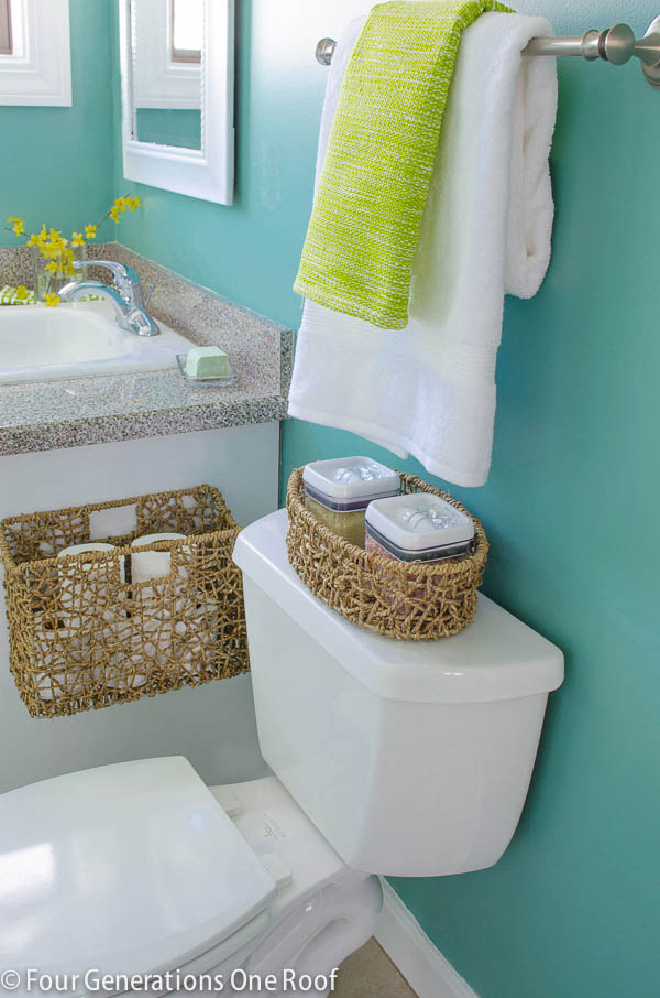 small green bathroom Toilet paper storage in a basket
