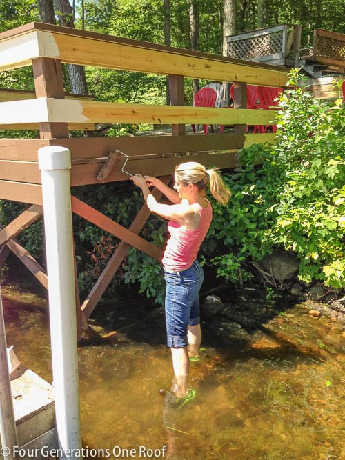 painting the deck in the lake