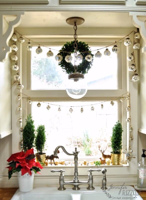 Window-framed-in-mercury-glass-garlands