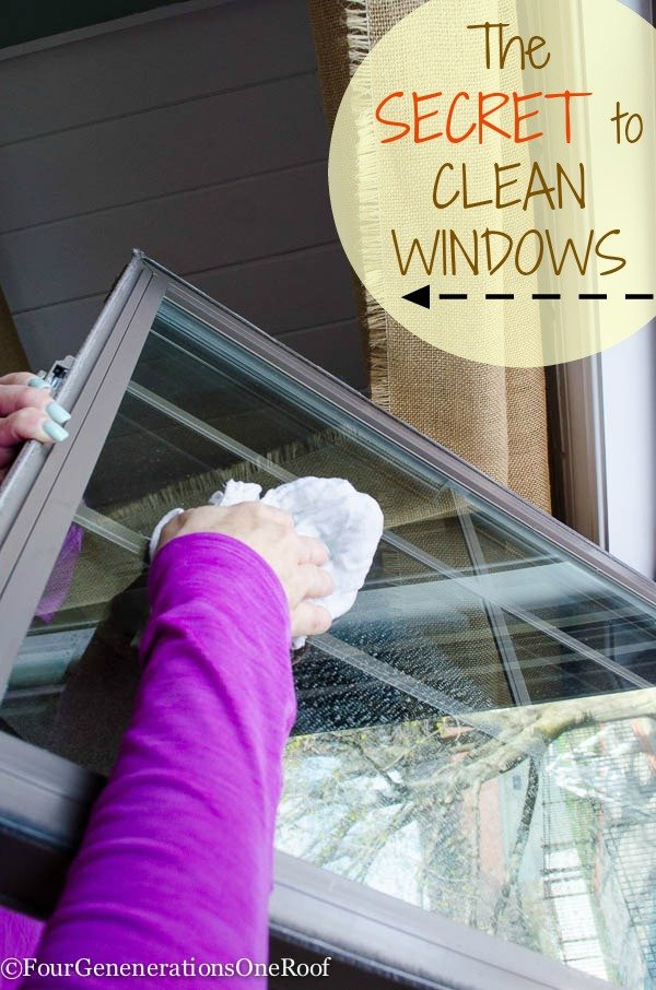 girl in purple shirt cleaning windows with vinegar and diaper cloth no streaks