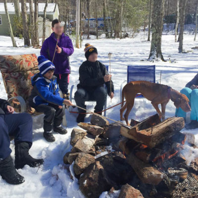 Roasting hot dogs in the snow {campsite winter vs summer}