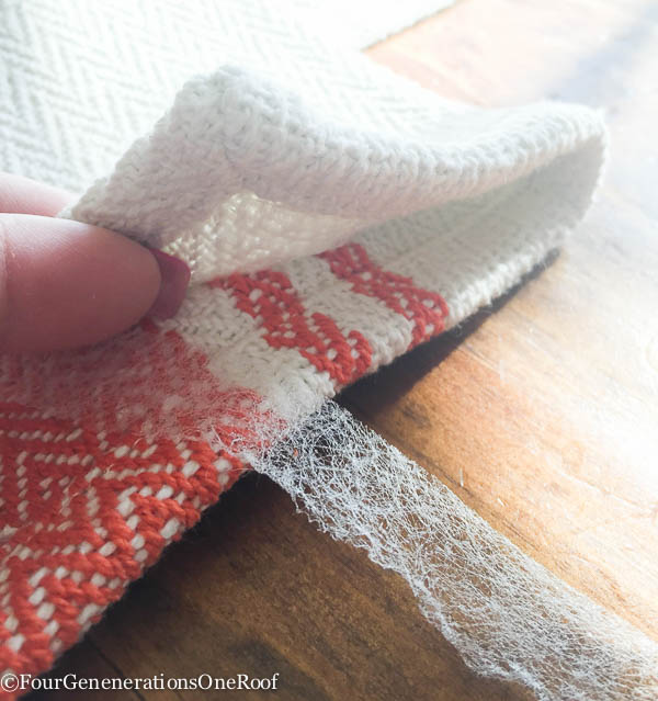 Use Stitch Witchery to make hem on a window valance from a table runner