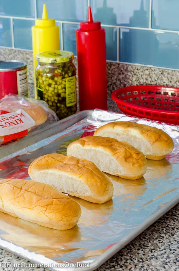 hot dog buns on baking sheet lined with tin foil, ketchup and mustard bottle, Kings Hawaiian Rolls