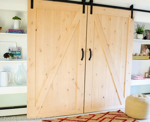 Our diy sliding barn doors tutorial four generations one roof diy sliding barn doors by masonite easy to install kit which includes all rolling door planetlyrics Gallery