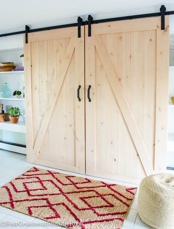 Our diy sliding barn doors tutorial four generations one roof for Diy interior barn door hardware