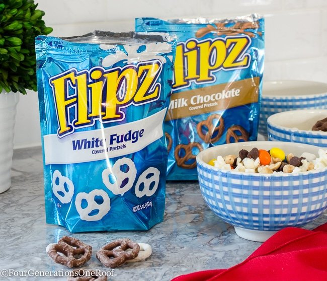 Popcorn and Pretzel snack mix using chocolate covered pretzels, m&m's, marshmallows, chocolate chips, nuts and popcorn