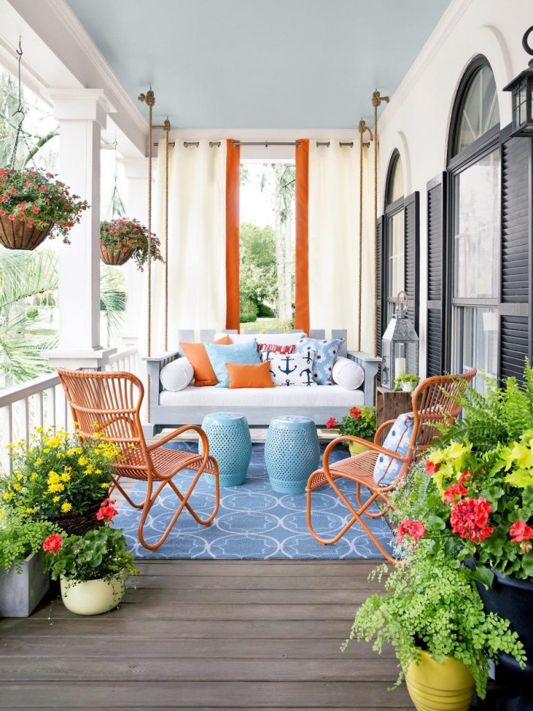 Charming Front Porch Ideas / Front Porch Swing And Drapes Conversation Area Via HGTV