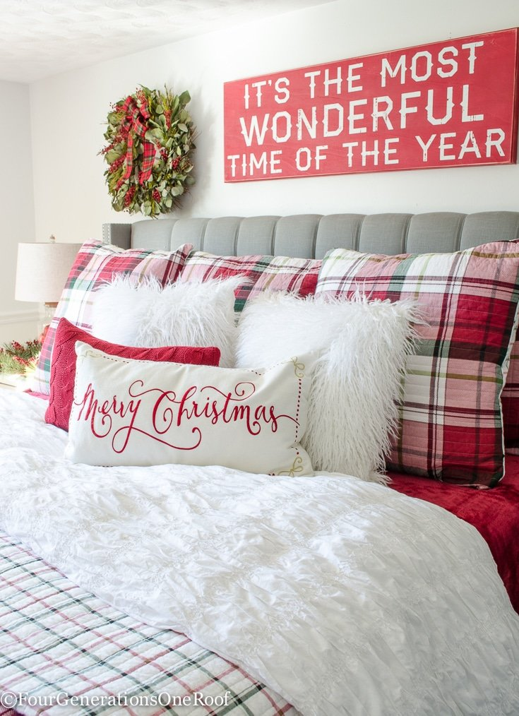 Plaid Christmas Bedroom / Featuring white walls, Red Plaid Bedding and a full spruce Christmas tree