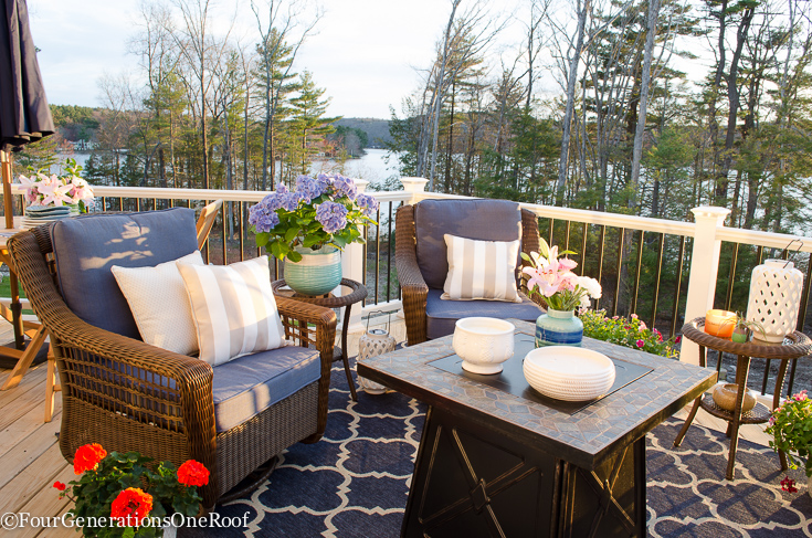 Snag Patio Furniture Under 0 {LakeSide Deck Reveal} How to create a cozy patio or deck space with affordable wicker furniture, lots of ceramic planters and a gorgeous firepit for ambiance. #patiofurniture #patio #deckfurniture #wickerfurniture #outdoors #outdoorfurniture #curbappeal #lakeliving #decor #decorating #exterior #outdoorseating