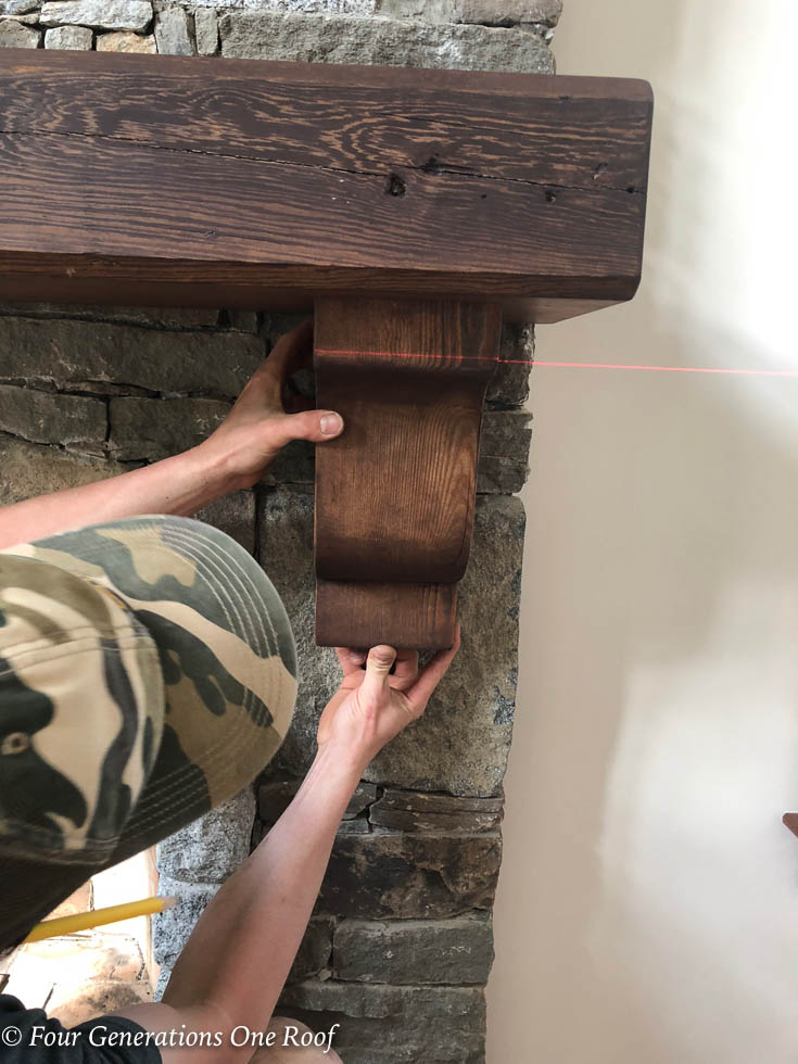 How to install a wooden beam mantel with Rebar | Steel Rebar Rod Install on Stone Fireplace | laser level to ensure mantel was level