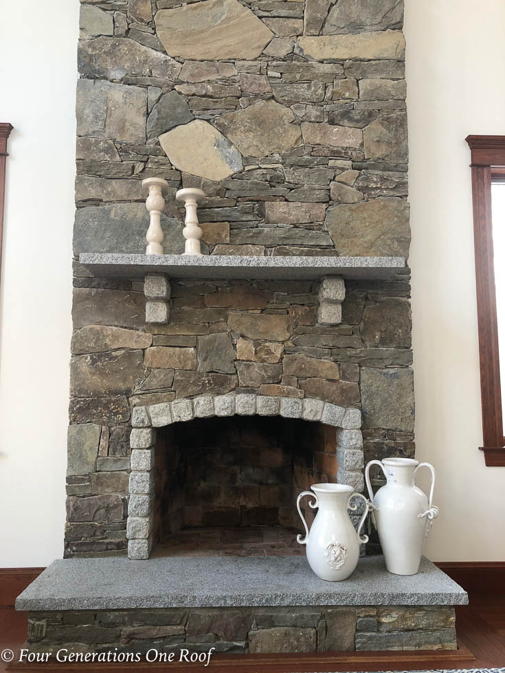 living room before with granite stone mantel