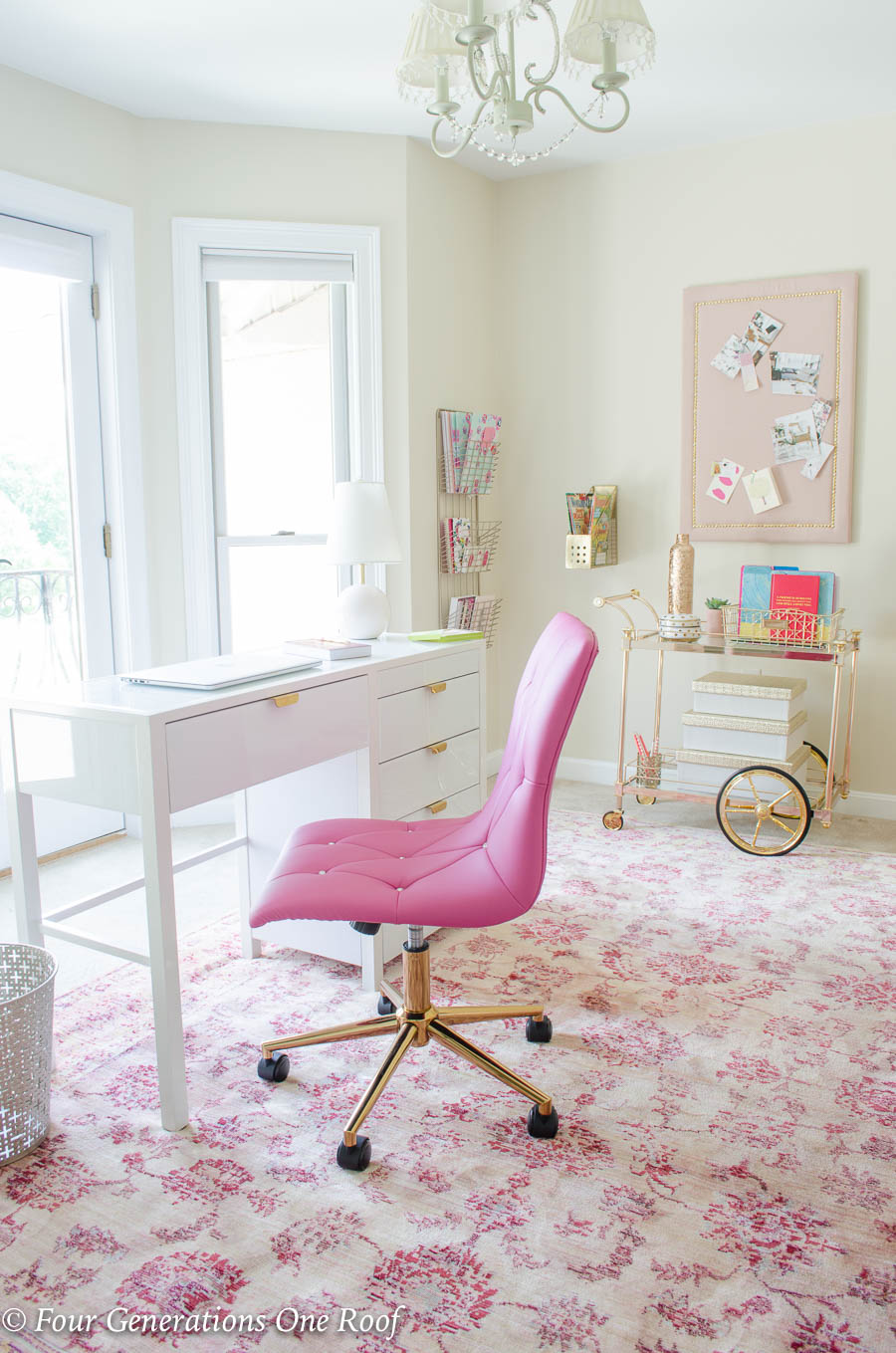 Sophisticated Adult Pink + Gold Glamorous Workspace  featuring a white and gold glass desk, pink studded office chair, pink rug, gold and blush glass bar cart for office storage, hanging wall pin board for storage and hanging letter holders and wire organization rack. #officestorage #pinkoffice #organizational #officemakeover #desk #pinkchair #officefurniture