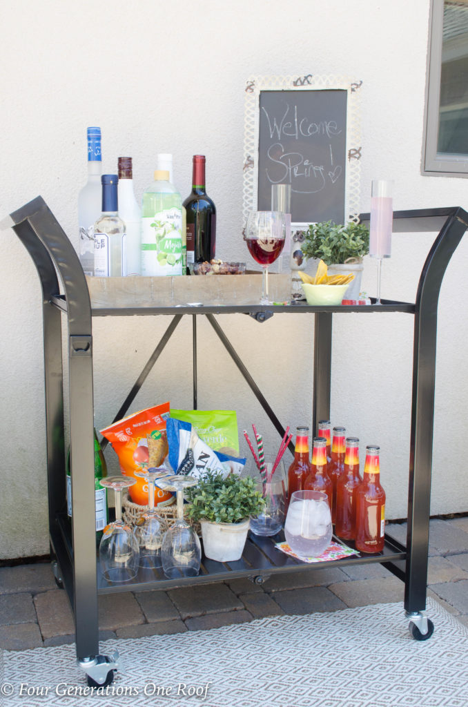 15 minute black metal bar cart setup | wooden tray filled with liquor and mixers | champaign glasses | chalk board sign