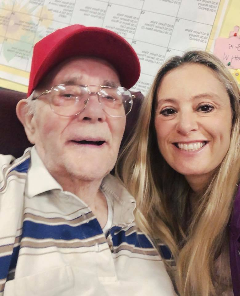 grandfather with dementia and grandaughter at nursing home