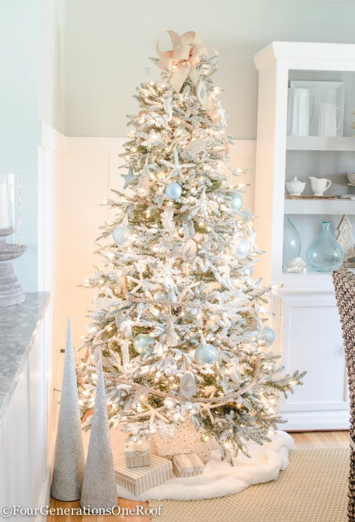 Coastal Flocked Christmas tree with blue, silver and burlap ornaments