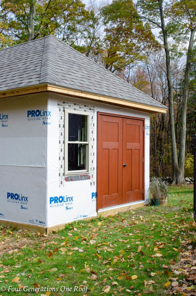 Pool House Masonite Heritage 3-Panel Craftsman Fir Textured Double Door Unit, finished with a Cherry stain in our Fortress Coatings shop