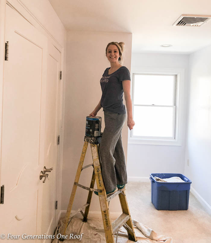 Jessica Bruno painting bedroom with white paint
