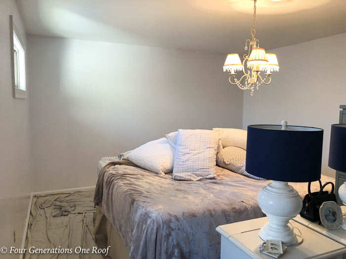 white bedroom painting projects Master bedroom with pink bedding, tan walls and blue lamp shades