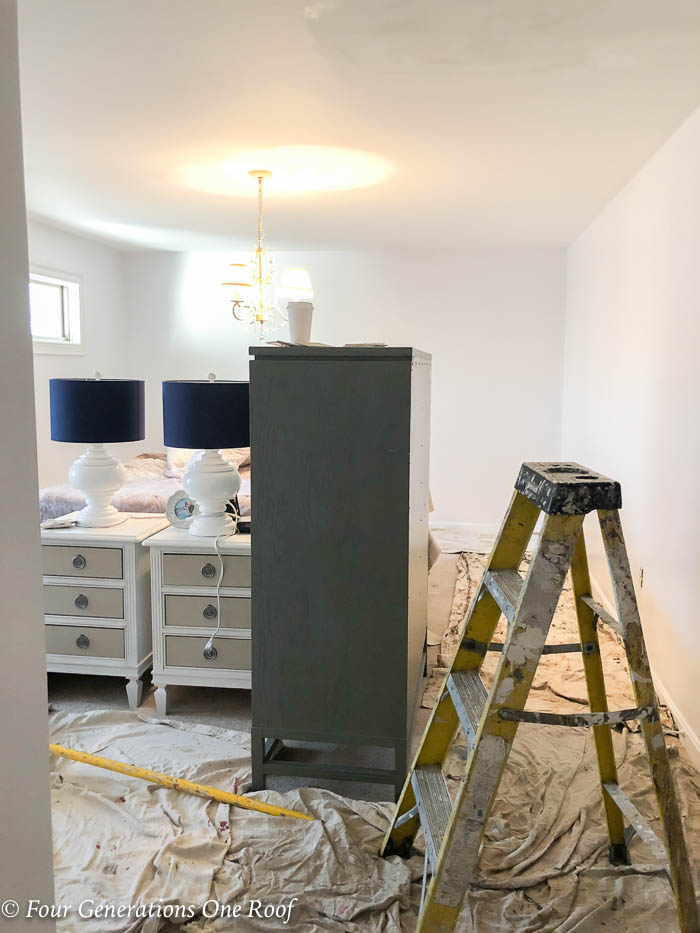 master bedroom makeover white walls furniture in middle of floor