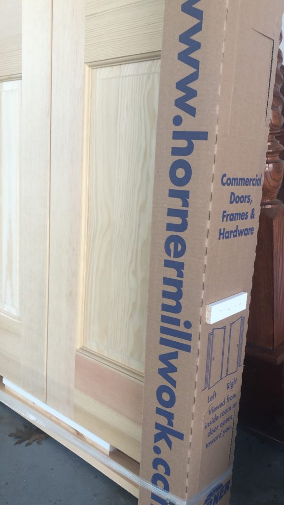 wrapped wooden french closet doors with no stain