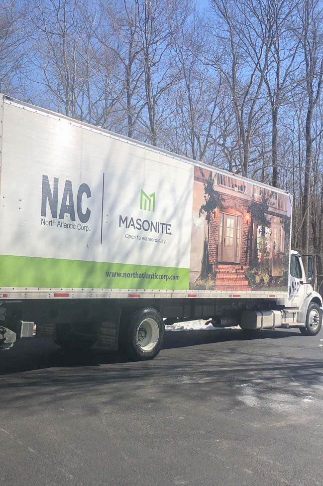 North Atlantic Corporation Horner Millwork truck delivering french closet doors