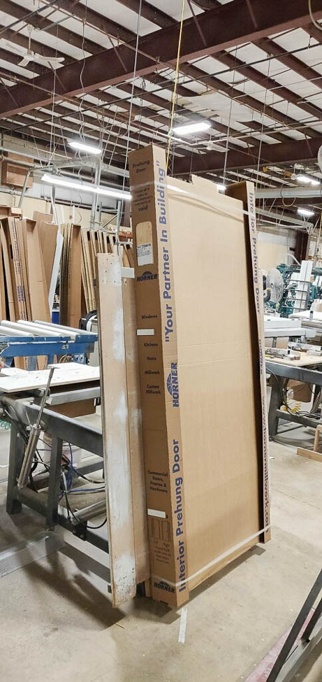 french closet doors double swing wrapped in cardboard for shipping