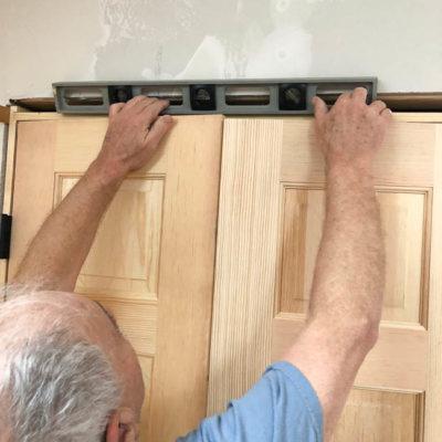 French Closet Doors Installation on Slanted Ceiling {Lady Loft}