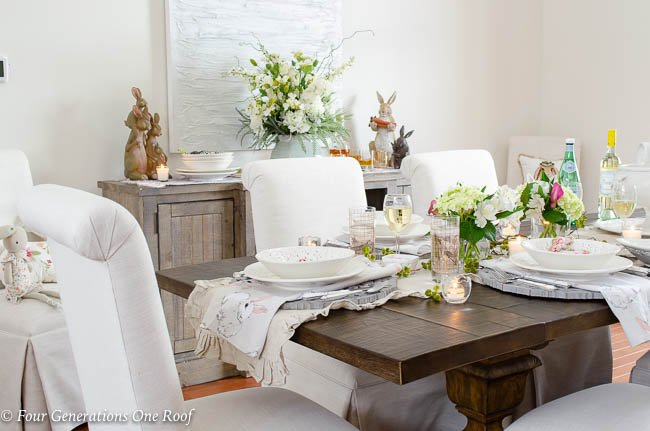 Table setting for Spring and Easter, white tuscan dishes, Easter linens, hydrangeas, wood scroll chargers, gold glassware, Easter bunnies, ruffled beige table runner