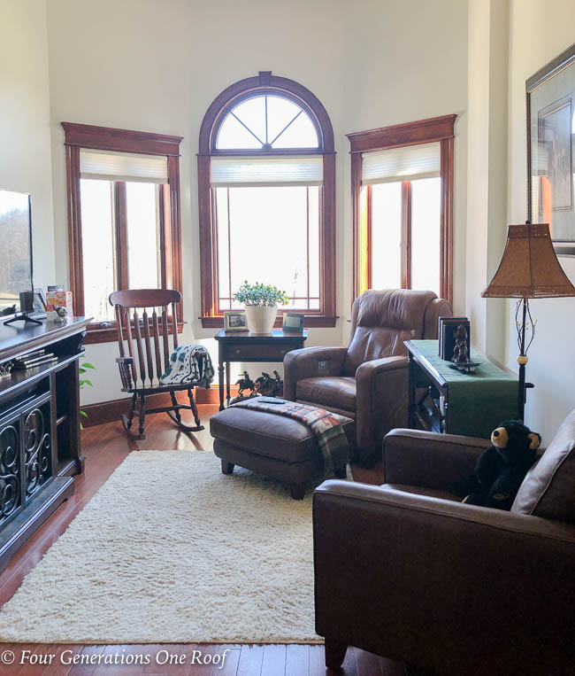 Small Living Room, blue accent chair and table , leather chairs, equestrian wall art, ralph lauren decor, dark wood media console