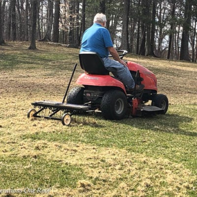 lawn dethatcher attached to mower, lawn thatch, raking lawn in Spring