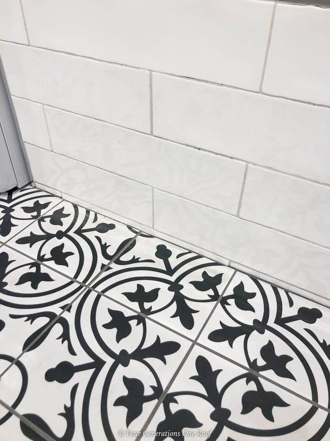 coordinating black geometric tile and white subway tile