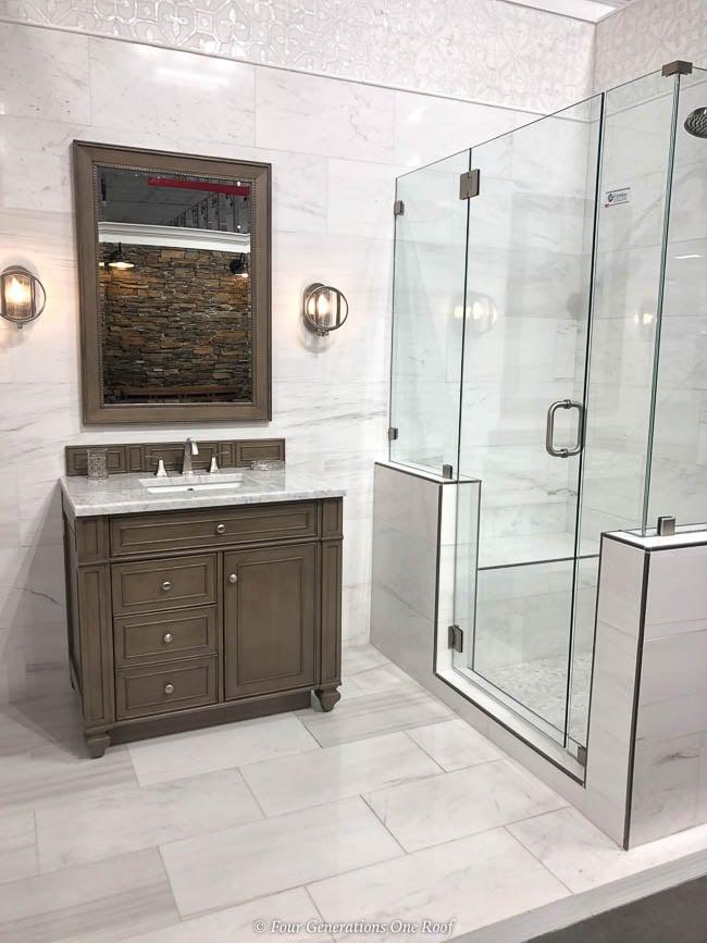 walk in glass shower, tile wall, tile floor, brown bathroom vanity Floor & Decor