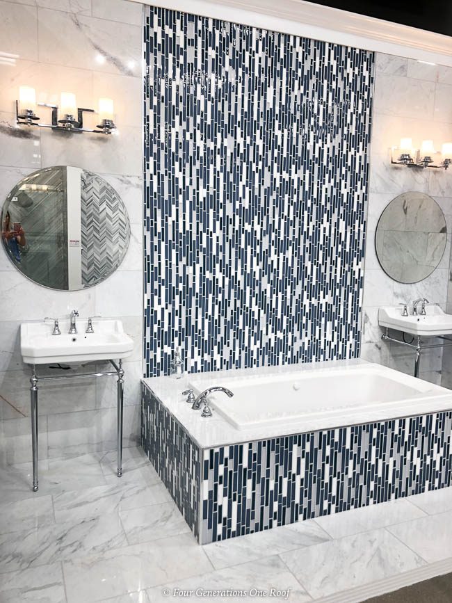 Blue mosaic wall and tub surround tile, white wall tile and industrial styled bathroom sinks