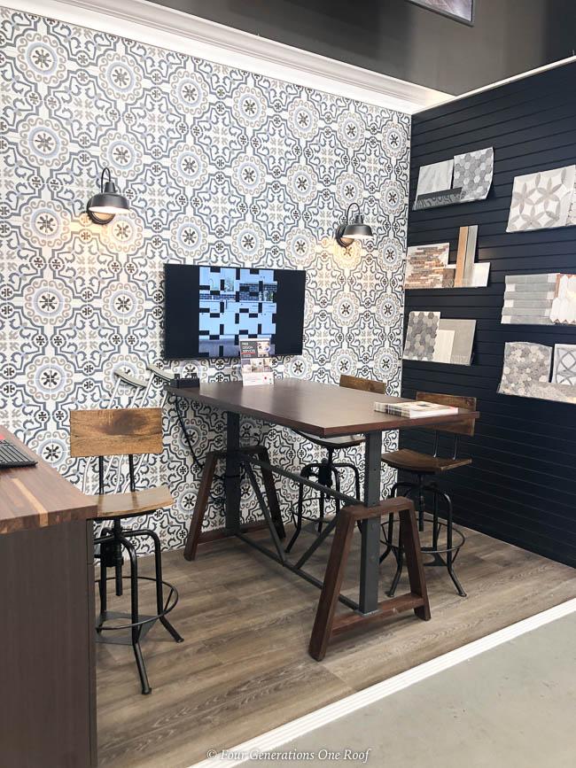 workstation with hardwood floor, geometric tiled wall