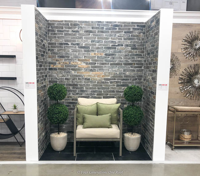 tiled wall, accent chair and topiaries