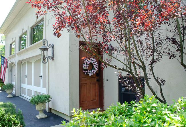 cherry stain side entrance garage door, wreath, 3 car garage, Side Entrance Garage Door Makeover with Schlage